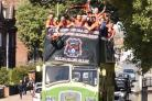 Celebrations - Duckpond FC taking to the streets of Harwich to celebrate winning their league and (inset) players show off their trophy                                             Pictures: Duckpond FC