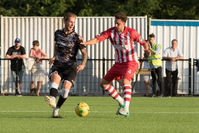 Friendly fire - Colchester United midfielder Ben Stevenson lays the ball off during his side's friendly win at Bowers and Pitsea Picture: NASH PHOTOGRAPHY
