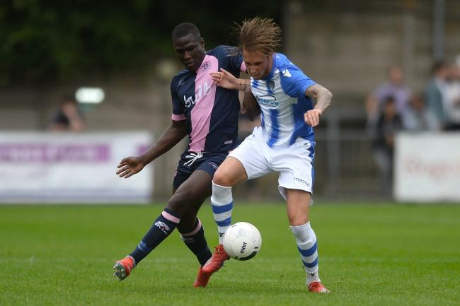 Hair-raising - Colchester United's Ben Stevenson battles for possession against Dulwich Hamlet Picture: Richard Blaxall www.richardblaxall.co.uk