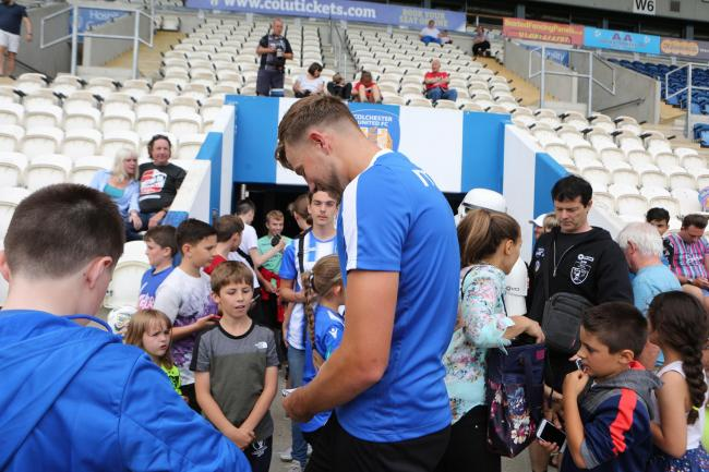 Star turn - Colchester United midfielder Harry Pell signs autographs at the club's annual Open Day Picture: SEANA HUGHES