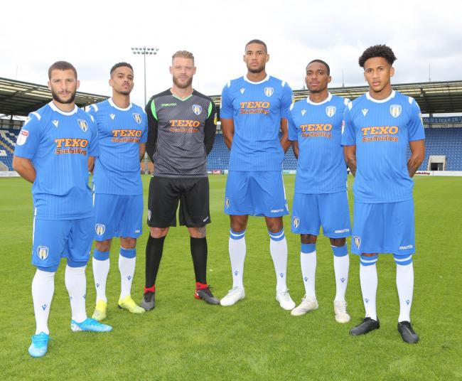 Dressed for success - Colchester United's new signings model the club's new home kit Picture: SEANA HUGHES