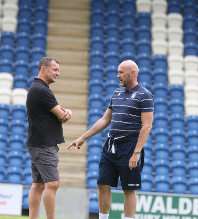 Discussion - Colchester United director of football Tony Humes (left) chats to head coach John McGreal Picture: SEANA HUGHES