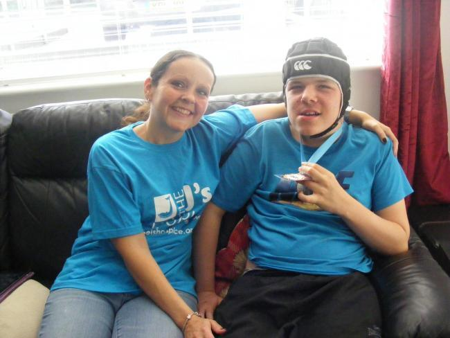 New wheelchair: Stacey Palmer with son Jason before a fundraising event for the J's Hospice