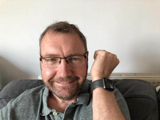 Paul Hutton with his Apple Watch at home in Bradfield