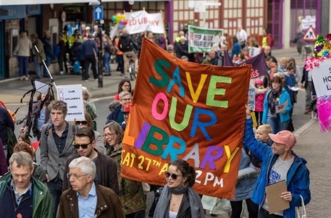 A Save Our Libraries march earlier this year