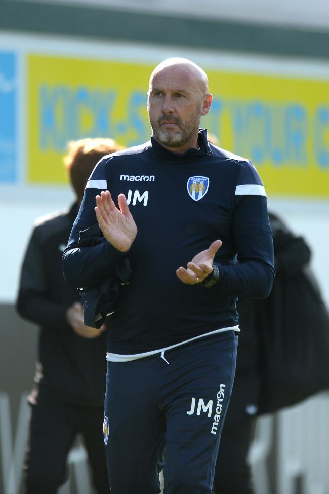 Thanks - Colchester United head coach John McGreal applauds the U's fans at Plymouth Argyle Picture: RICHARD BLAXALL