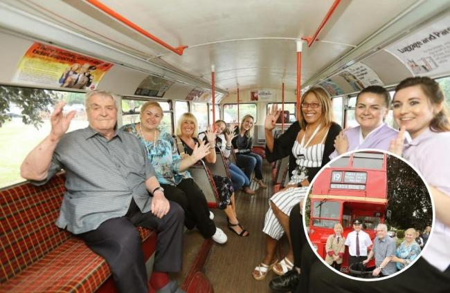 All aboard - former bus driver John Northcott and staff from his nursing home on board a bus for a special trip down memory lane