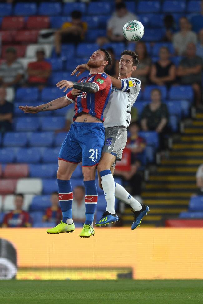 Impressive - Colchester United defender Luke Prosser challenges Connor Wickham of Crystal Palace during the U's Carabao Cup triumph Picture: RICHARD BLAXALL