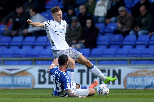 Youth and experience - Colchester United left-back Ryan Clampin looks to get past Chris Eagles of Oldham Athletic Picture: RICHARD BLAXALL