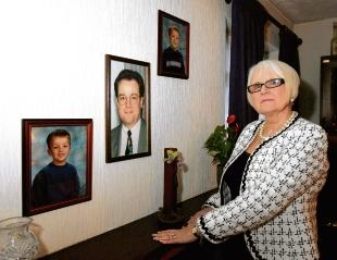 Patricia Bingley with pictures of her son, Kevin, centre, who died in the World Trade Centre terrorist attacks, and grandsons Elliott, left, and Ryan, right, with whom she has lost contact