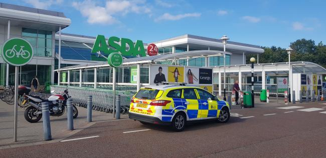 Scene - police at Asda in Turner Rise, Colchester, after a woman said a man had tried to kidnap her and her son