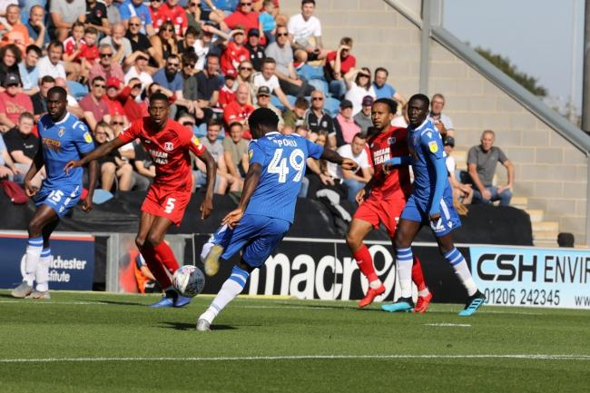 On target - Kwame Poku scores Colchester United's opening goal against Leyton Orient Picture: STEVE BRADING