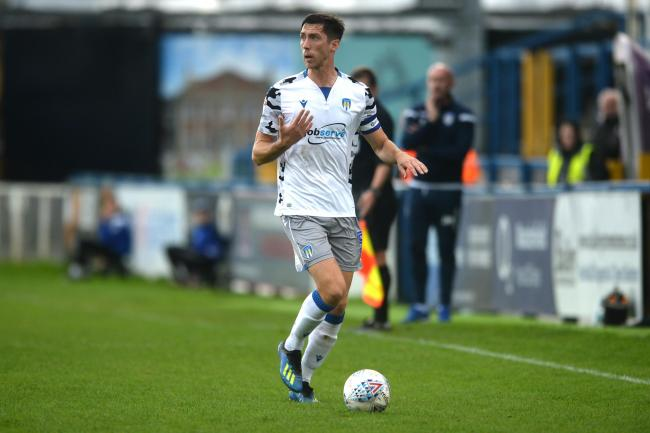 Leading the way - Colchester United skipper Luke Prosser in action at Macclesfield Town Picture: RICHARD BLAXALL