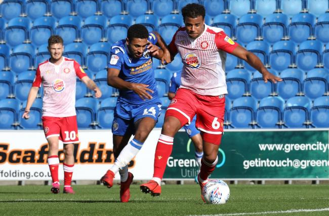 Tussle - Brandon Comley battles for the ball with Stevenage midfielder Tom Soares during Colchester United's 3-1 win Picture: STEVE BRADING