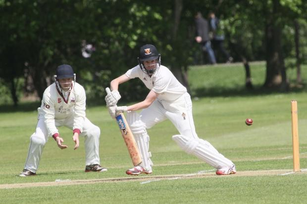 Hitting out - Colchester's Julian Russell in action at Castle Park