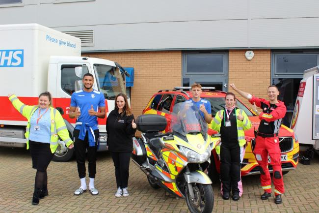 Volunteers show they have given blood for the Herts and essex air ambulance