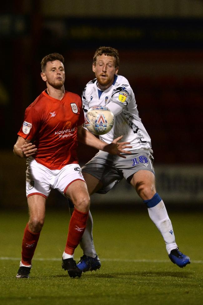 Tom Eastman of Colchester United does battle with Chris Porter of Crewe Alexandra - Crewe Alexandra vs. Colchester United - Sky Bet League Two - Gresty Road, Crewe - 22/10/2019 - Photo by: Richard Blaxall