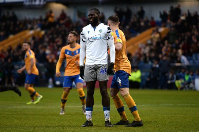 Disappointment - Colchester United forward Frank Nouble looks dejected after having his penalty saved by Mansfield keeper Conrad Logan Picture: RICHARD BLAXALL
