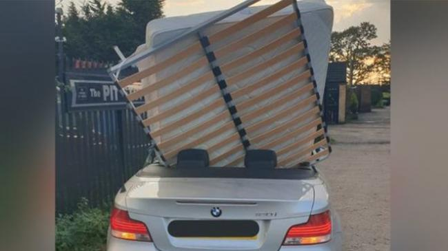 BMW carrying double bed