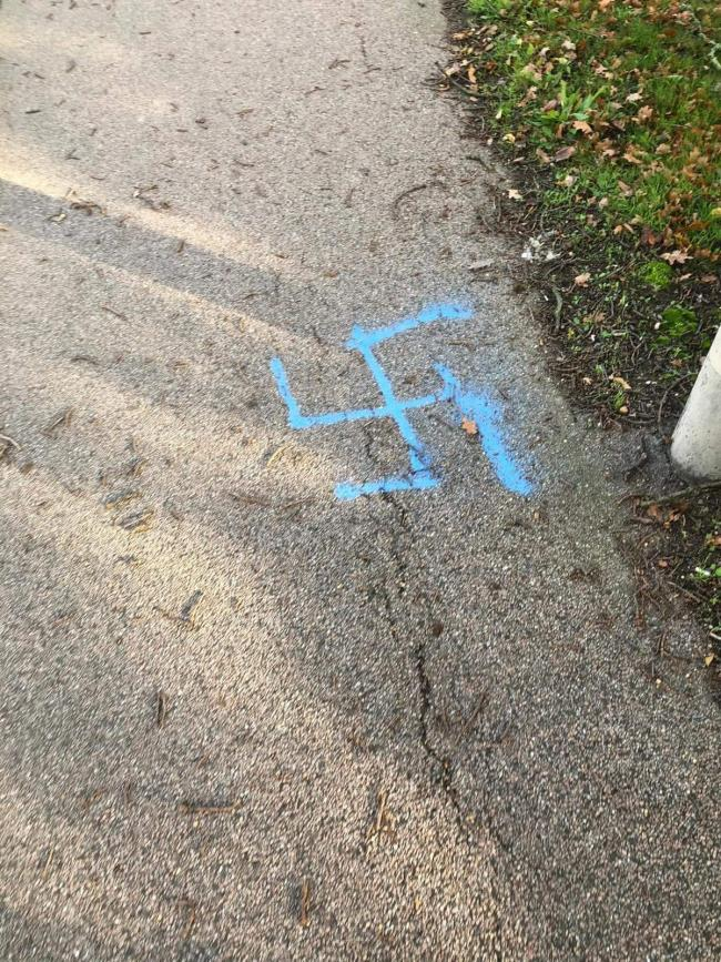 Discovery - a swastika on the pavement and (inset) Martin Goss
