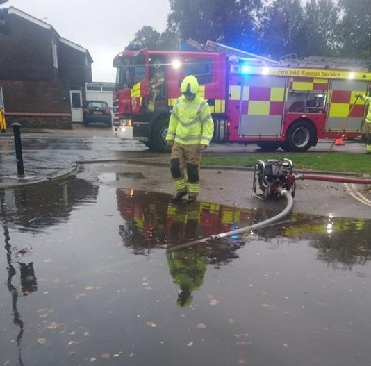 Flooding - fire crews work to pump water from East Bay, Colchester