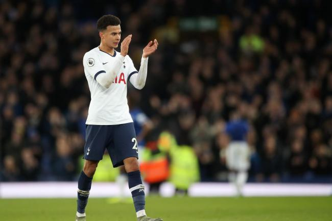 Dele Alli applauds the Tottenham fans