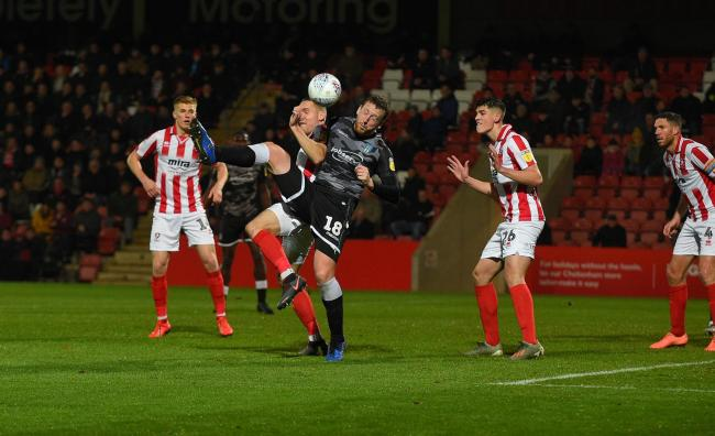 High ball - Colchester United defender Tom Eastman tries to make a nuisance at a corner against Cheltenham Town Picture: PAGEPIX