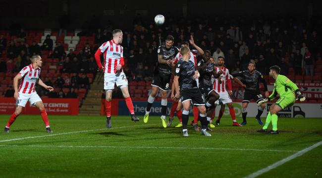 Near miss - Colchester United go close during the second half at Cheltenham Town as a free-kick is whipped across the six yard box Picture: PAGEPIX