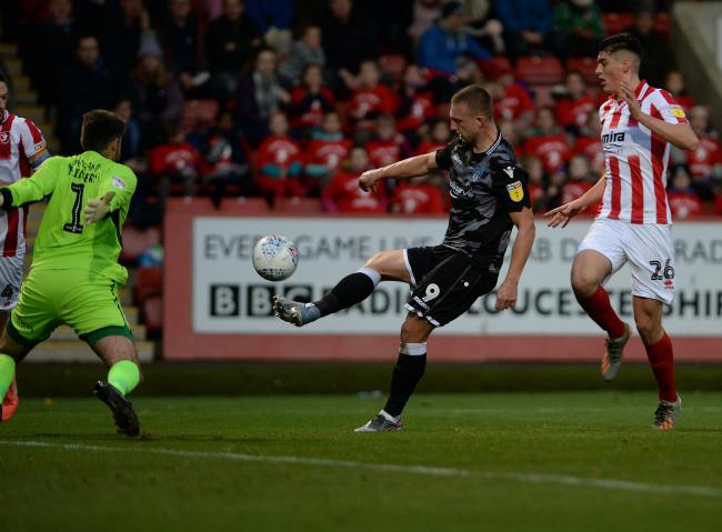 Hot shot - Colchester United striker Luke Norris scores during the first half at Cheltenham Picture: PAGEPIX