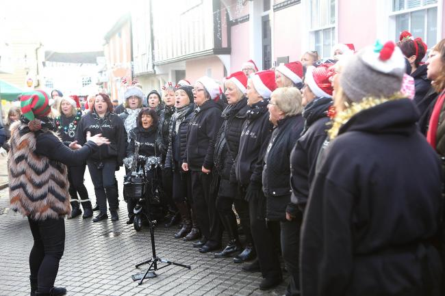 A choir sings at the South Lanes market