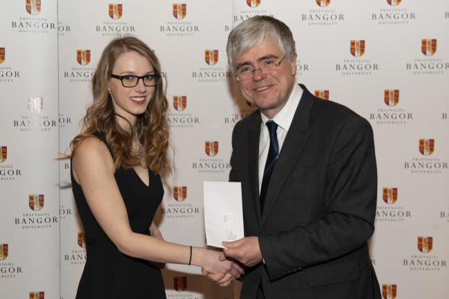 Award - India Talora De Verre from Stanway receiving her award from prof Iwan Davies, vice-chancellor of Bangor University