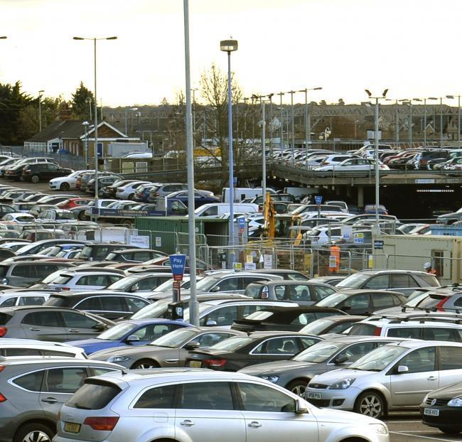 Busy - Colchester Station's car park which has been described as an unattractive concrete dump by Martin Goss (inset)