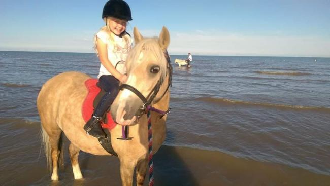 Joy - Emma Overton's daughter Alana rides on the beach