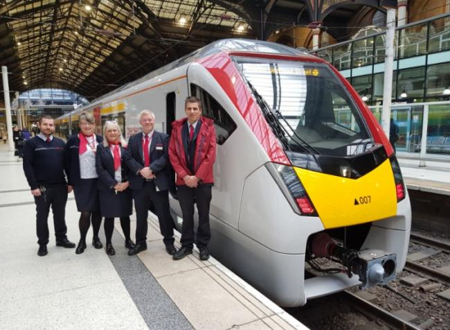 Innovative - Greater Anglia crew with one of the new intercity trains