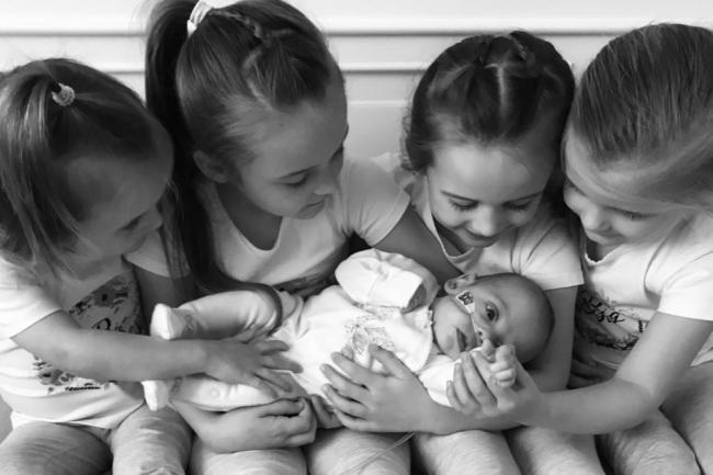 Protective - baby Louise with her four caring sisters at home before she was admitted to hospital in London