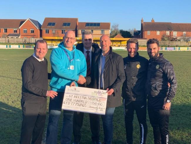 Worthy cause - Simon Grylls, of Thurlow Nunn Ltd, presents a cheque to Graham Miller, a fundraiser ambassador for St Helena Hospice. Also in the picture, from left, are Stanway vice-chairman Kevin Mather, Peter Hutchings, from the Thurlow Nunn League, Sta