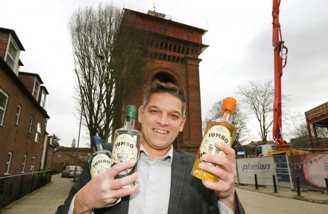 Chris Hayter, who brews Jumbo Gin, pictured in front of the water tower in Colchester.
