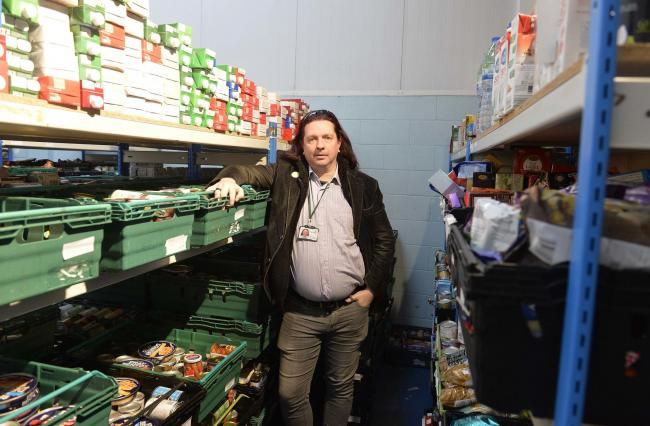 Colchester Foodbank manager Michael Beckett, in the food store..