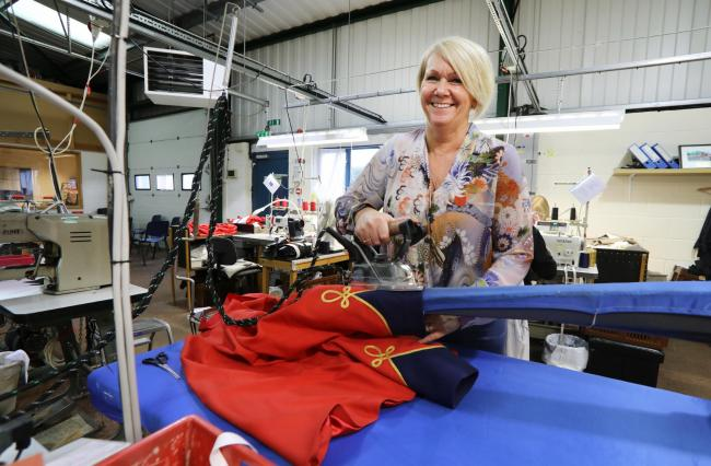 Bespoke designs - Donna Jewell pressing a tailored uniform which has been stitched at the factory        Pictures: STEVE BRADING