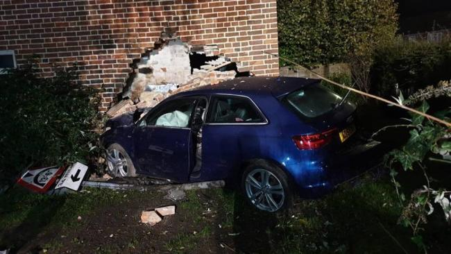 Damage: The blue Audi which crashed into Terry Spires' home
