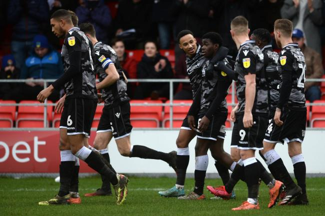 Celebration time - Kwame Poku celebrates with his Colchester United team-mates after scoring at Salford City Picture: RICHARD BLAXALL