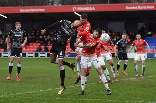 Heads up - Colchester United defender Omar Sowunmi rises for a header against Salford City Picture: RICHARD BLAXALL