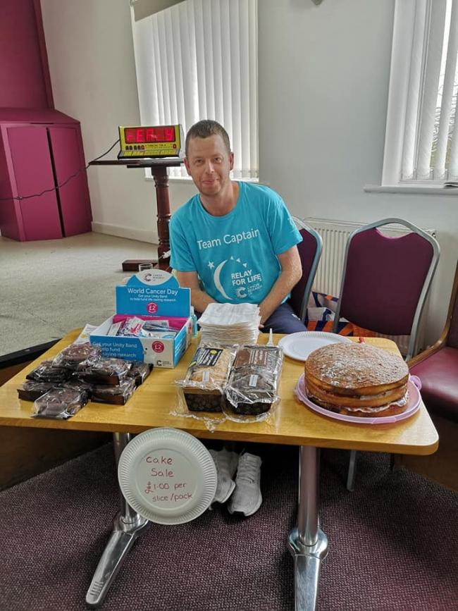 CHARITY APPEAL: team captain, Adrian Sexton, manning the cake sale stand