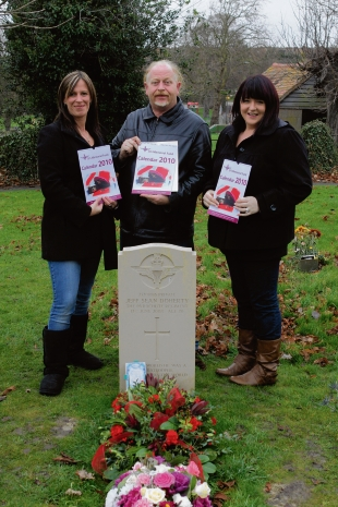 In memory – JJ Doherty's parents Joyce and Jeff with Kara Deakin, all trustees of the JJ's Memorial Fund, holding copies of the charity calendar at his grave