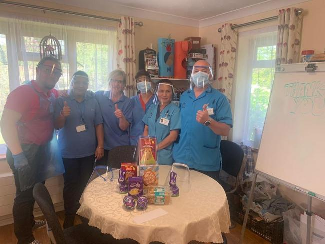 Inventive - care home staff with some of the finished PPE kit