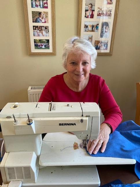 Keep sewing: Angela making scrubs for local NHS staff