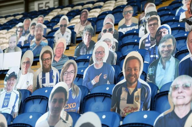 Support - Colchester United's fan cutouts during their play-off semi-final against Exeter City Picture: RICHARD BLAXALL