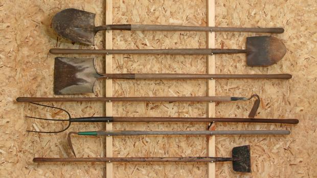 Gazette: Get heavy tools, rakes, shovels, etc., off the floor using utility hooks or, even, nails. Credit: Getty Images / Twoellis