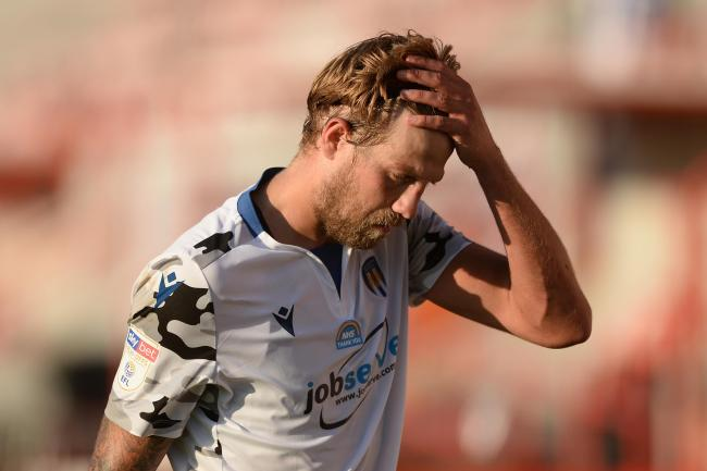 Anguish - Colchester United midfielder Harry Pell is left dejected at the final whistle at Exeter City Picture: RICHARD BLAXALL