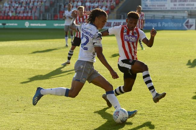 Debut - Colchester United defender Miles Welch-Hayes looks to get past Jayden Richardson of Exeter City during the U's play-off semi-final at St James Park Picture: RICHARD BLAXALL